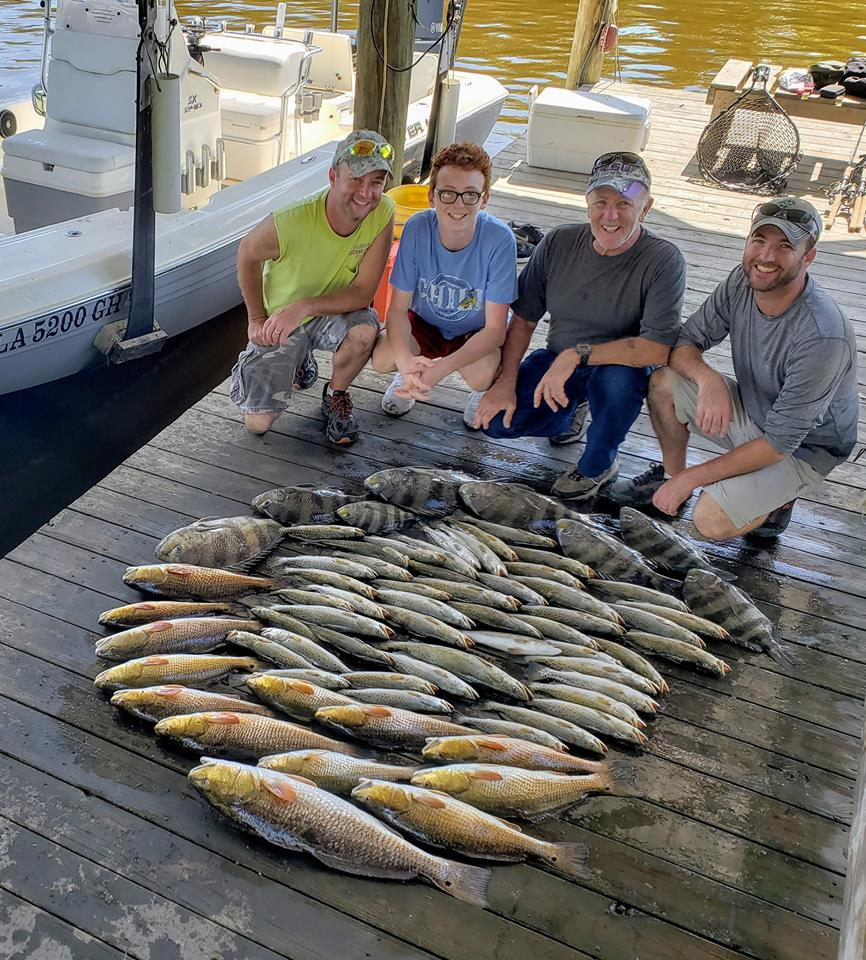Lets Geaux Fishing Guide Service on a boat dock with a family