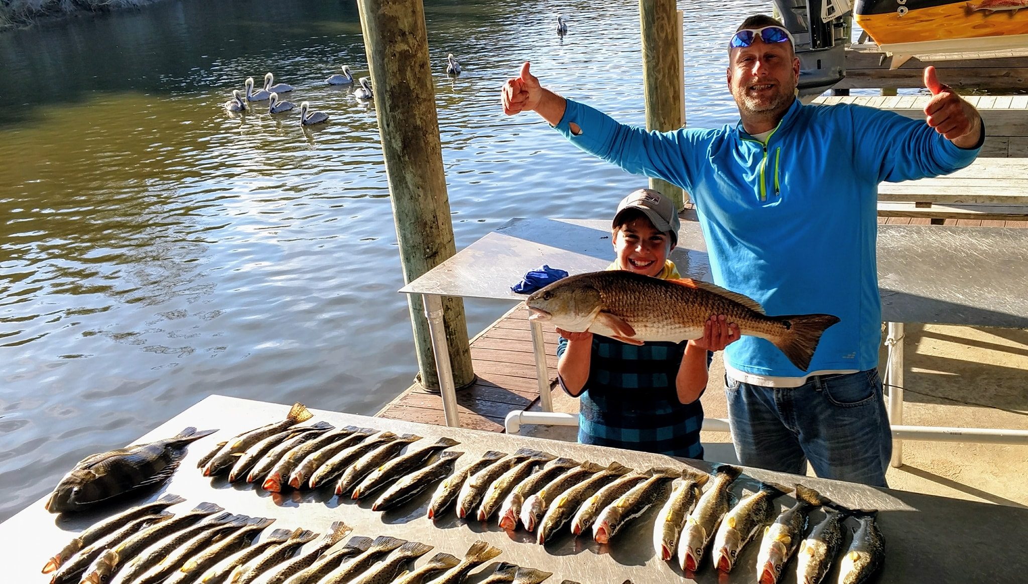 Lets Geaux Fishing Guide Service with child holding large fish