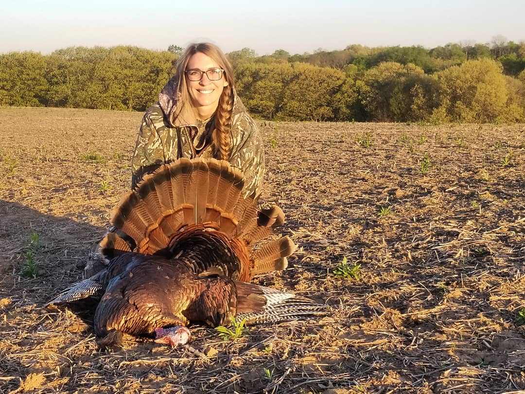 woman with harris outfitters turkey hunting in missouri