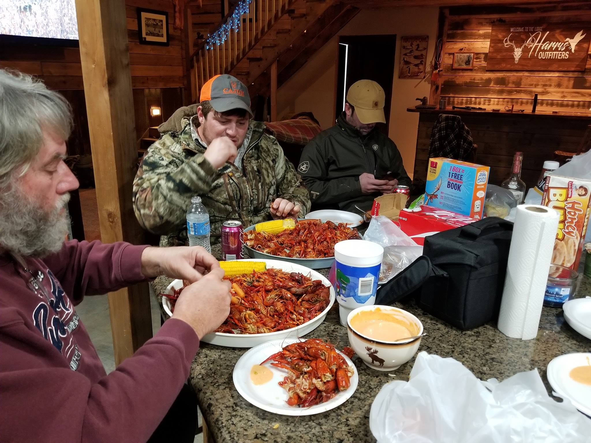men eating at missouri duck hunting lodge with harris outfitters