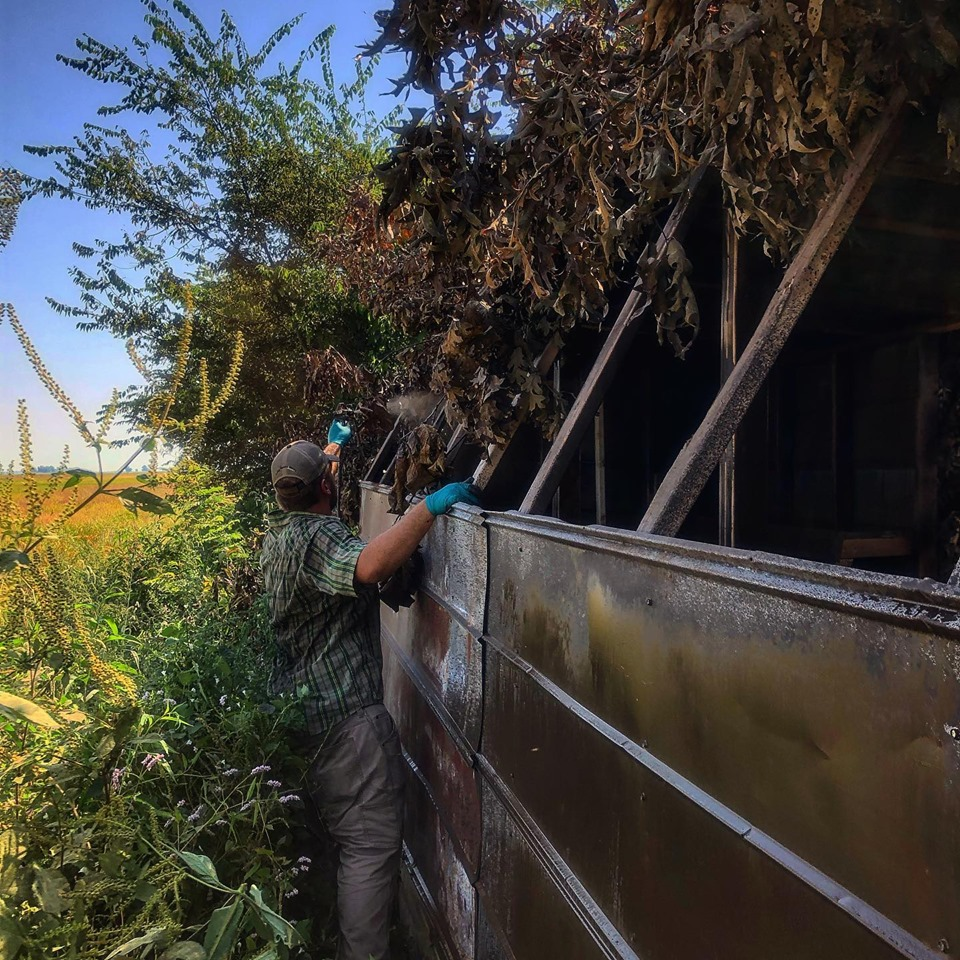 A man getting a blind ready a hunt with Fowl Lifestyle Outfitters