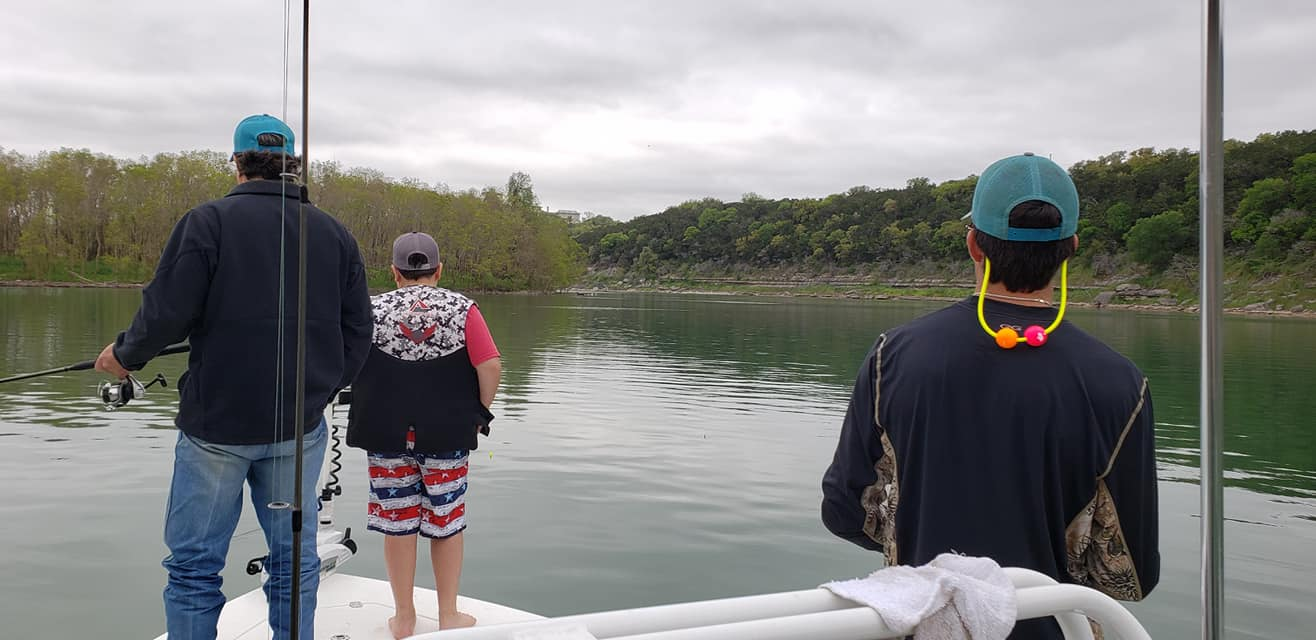 A father and his two boys fishing on Bubba J's Guide Service's bass boat with there