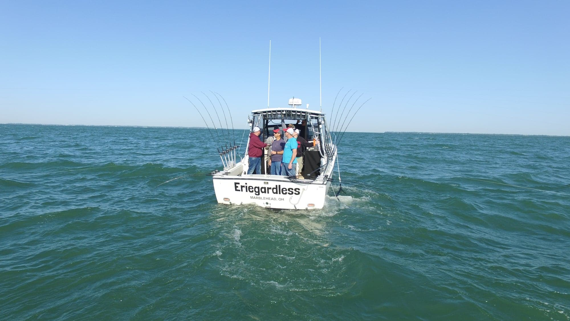 Eriegardless Sportfishing Charters boat drifting on Lake Erie  fully stoked with Rods and Reels and equipment