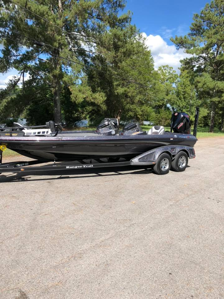 Donald Johnson Fishing guides bass boat on a trailer
