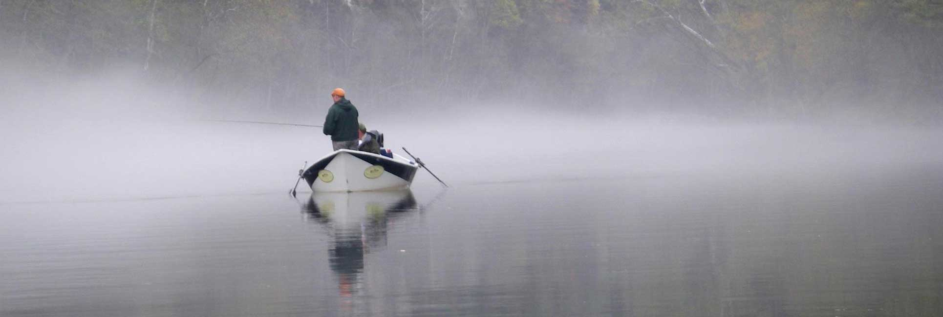 fly fishing guide on a fishing boat in Georgia with foggy weather