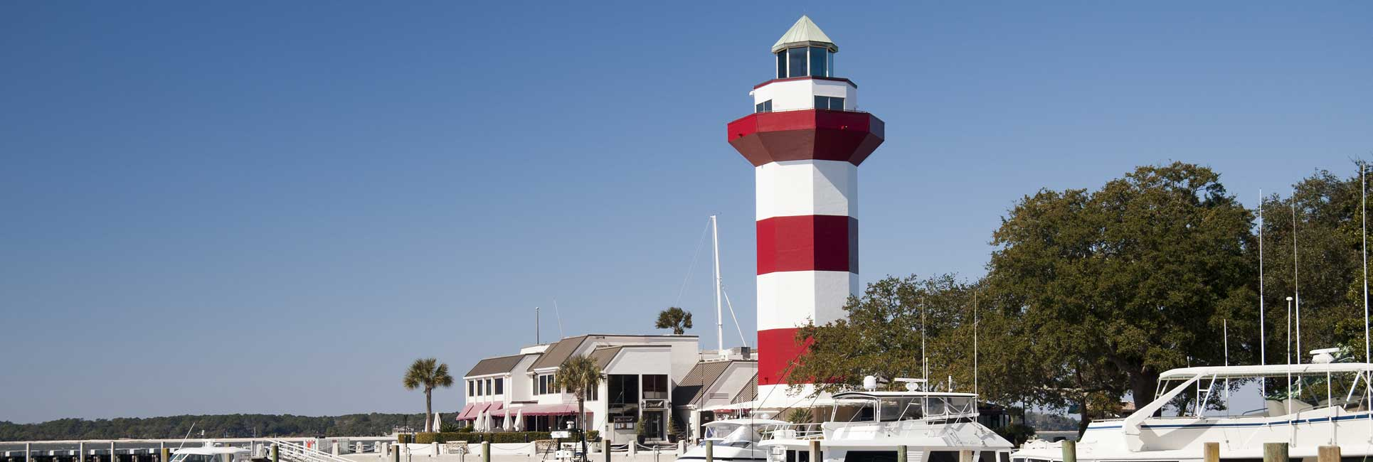 The iconic red and while lighthouse over looking the bay in Hilton Head, SC