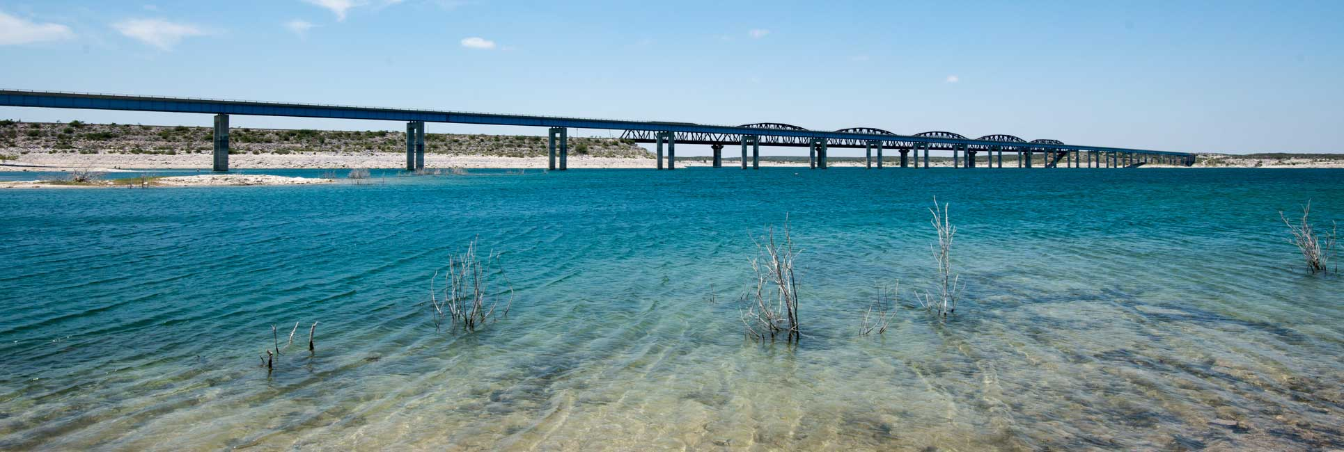 A highway bridge that runs across the fishing spots of Lake Amistad, TX